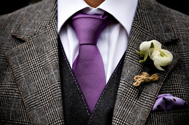 groom with purple tie