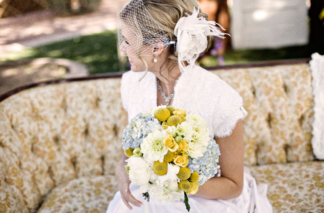 bride with birdcage veil and bouquet billy buttons