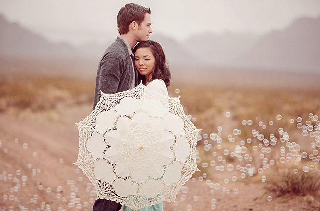 engagement photos with bubbles and parasol