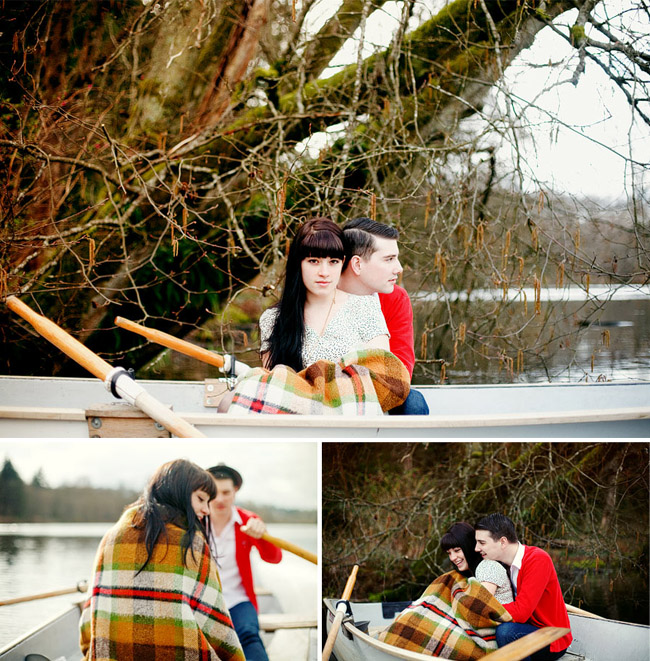 couple with blanket in row boat