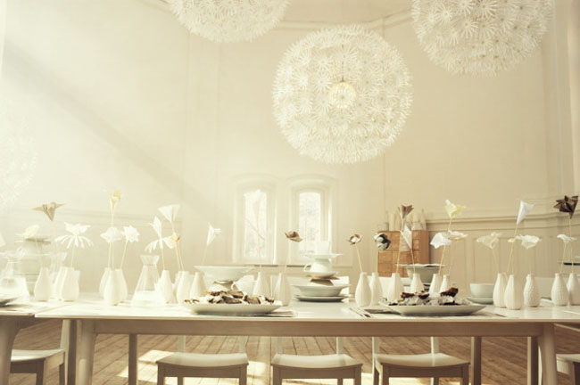 white tablescape with globes and origami
