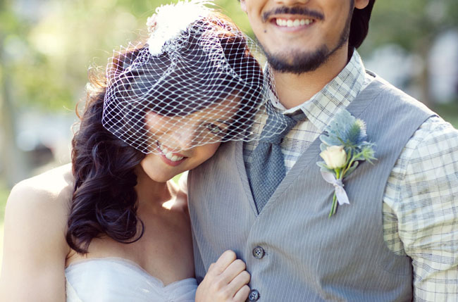 groom in vest birdcage veil