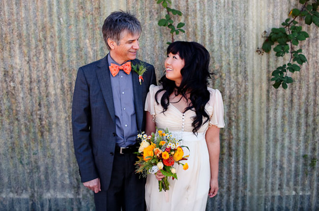 couple with yellow wildflower bouquet