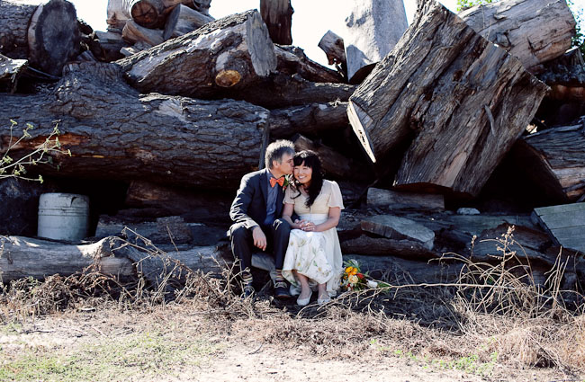 couple sitting on logs