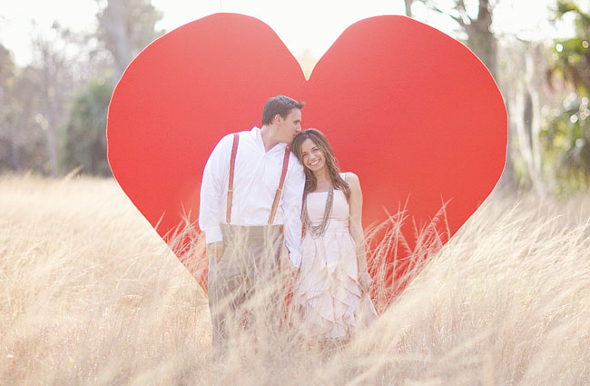 giant red heart and couple