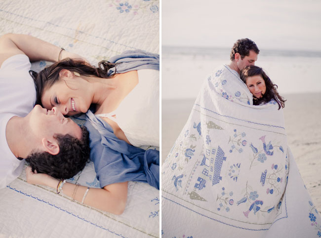couple wrapped in blanket on the beach