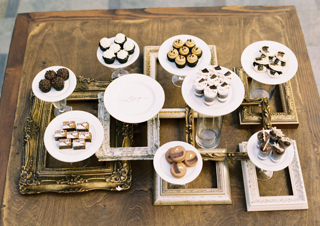 dessert table with picture frames
