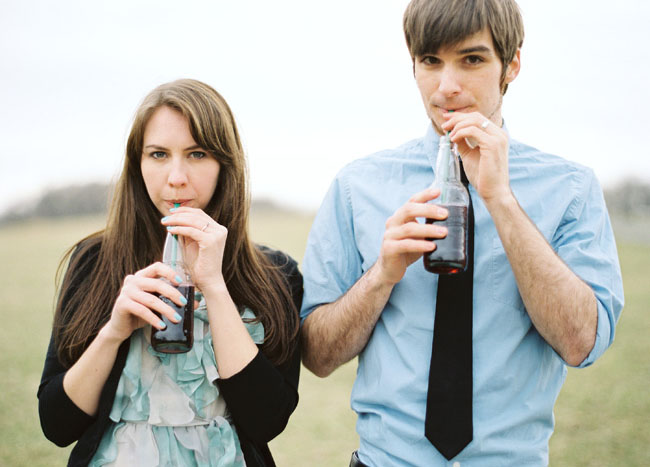engagement photos with soda bottles