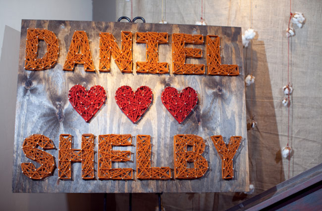 wedding sign with nails and string