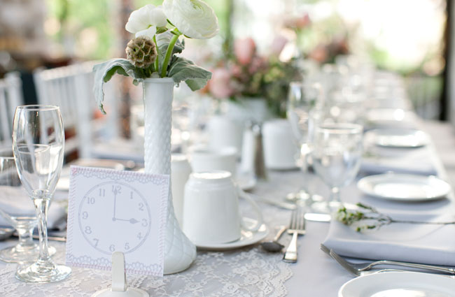 white table with pink and green flowers