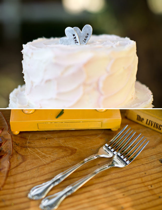 cake with metal heart cake topper
