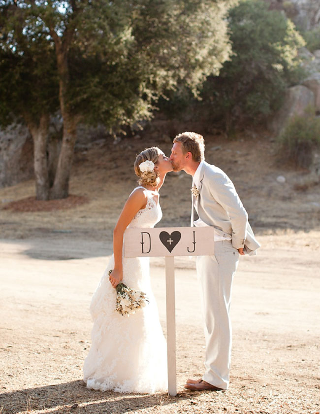 wedding portraits by a sign