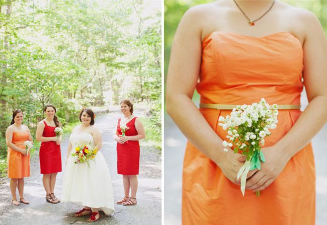 bridesmaids in orange and red dresses
