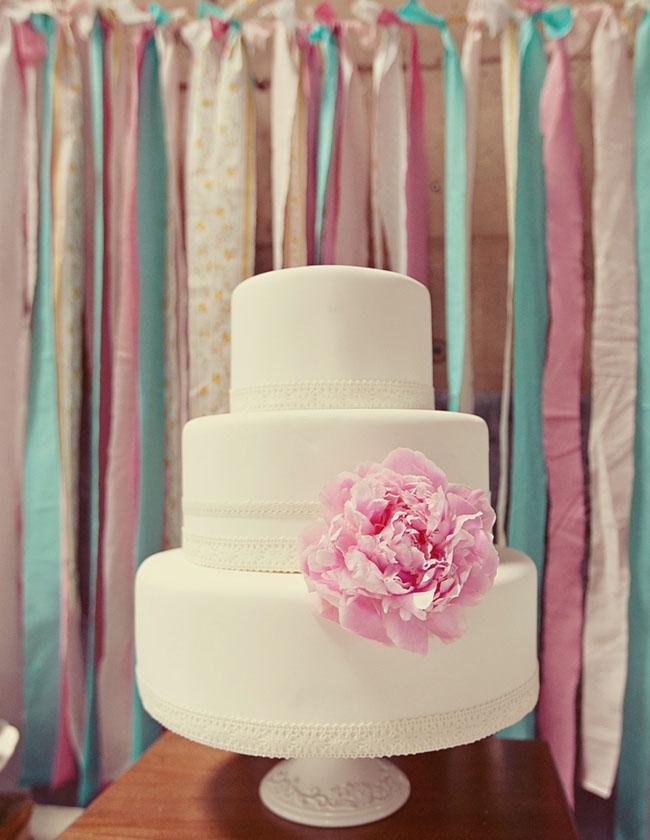 cake dessert display table ribbons hanging