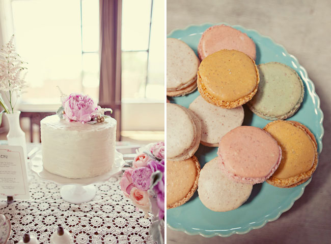 macaroons and wedding cake with flower on top