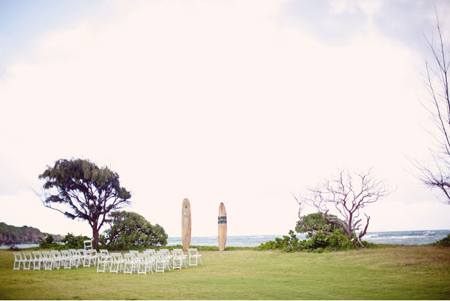 beach wedding with surf boards for the altar