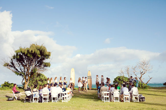 wedding on the beach with surfboards