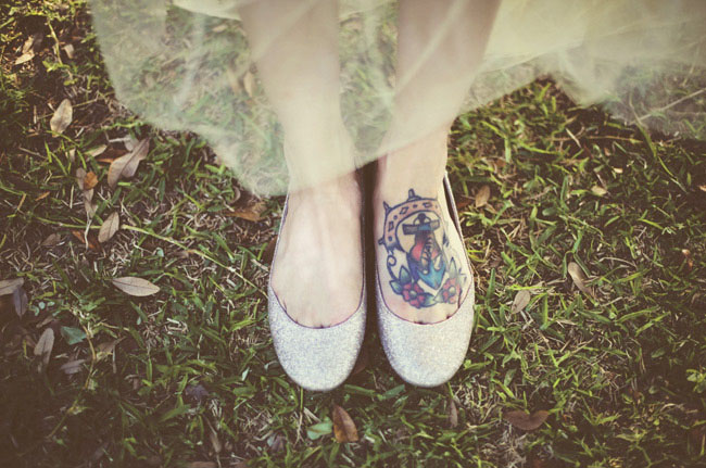 bride in shoes with tattoos