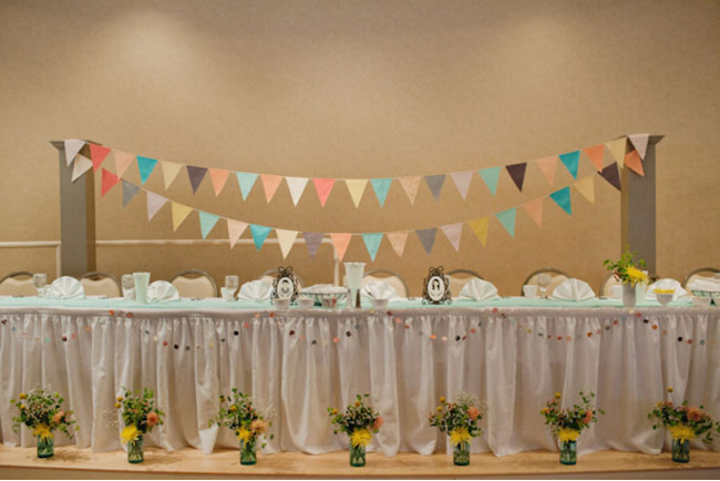 colorful flags over wedding table