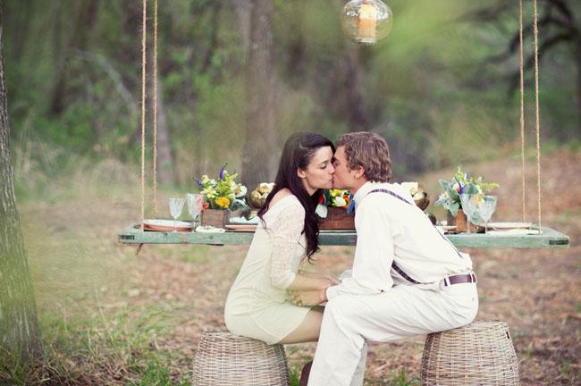 couple kissing on barrels