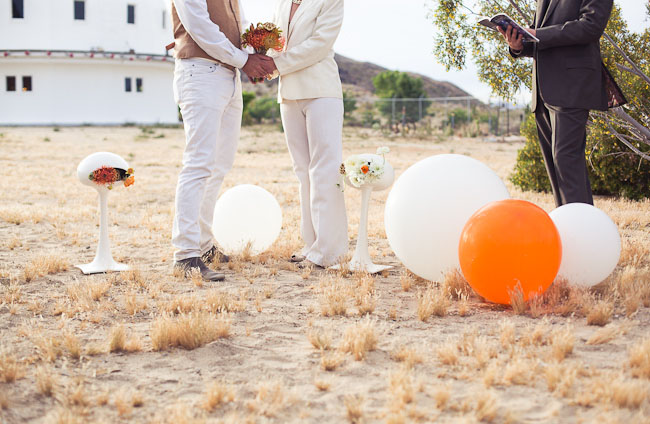 wedding ceremony outdoors with giant balls
