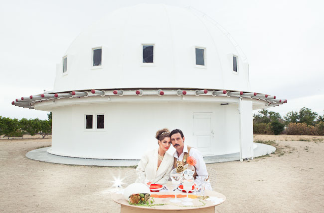 bride and groom married at planetarium