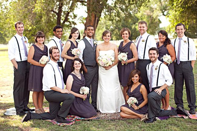 bridal party with groomsmen in suspenders
