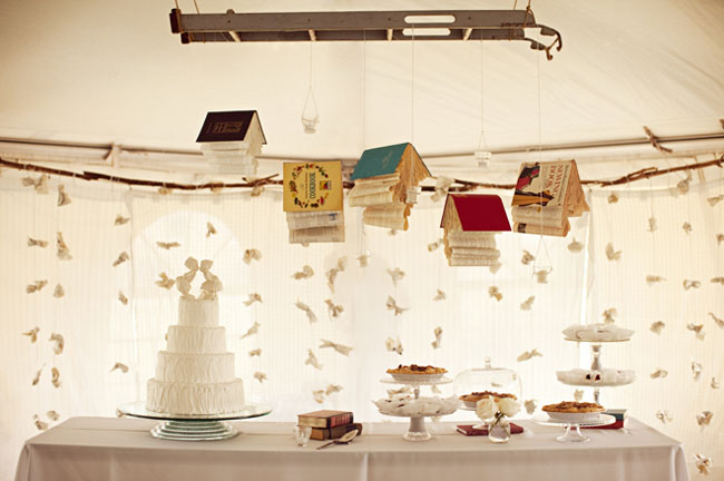 hanging books at a wedding over dessert table