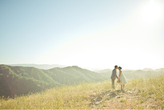 bride and groom on mountain top field