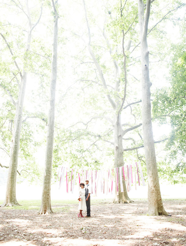 elopement in woods with fabric bunting