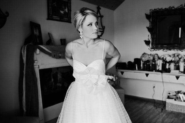 bride in spaghetti strap dress