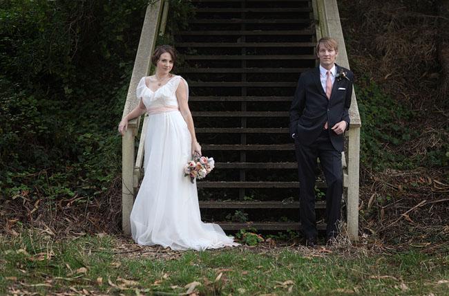 bride with wedding dress and pink sash