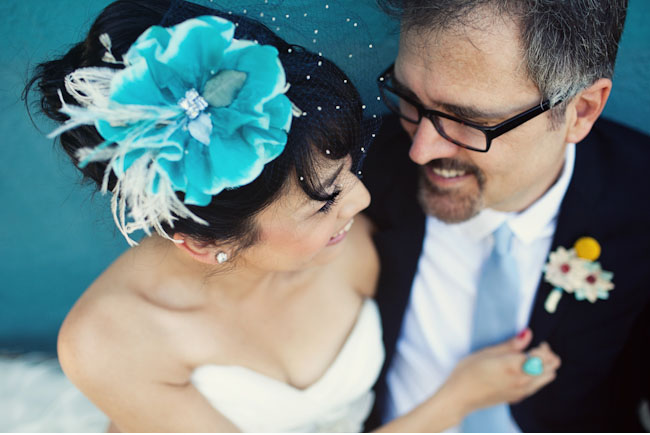 bride with teal flower hairpiece