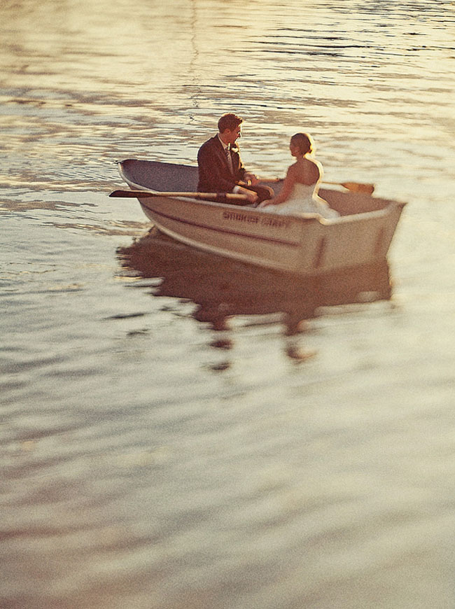 bride and groom row boat