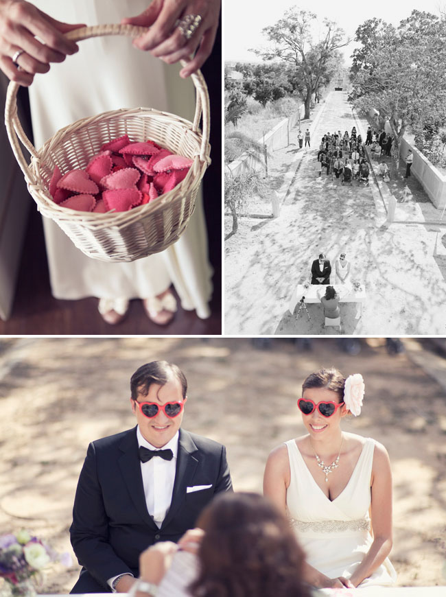 bride and groom wearing heart-shaped sunglasses