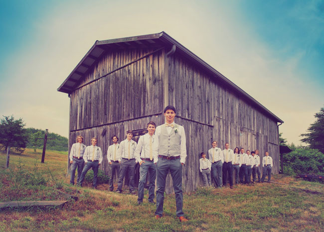 groomsmen at barn