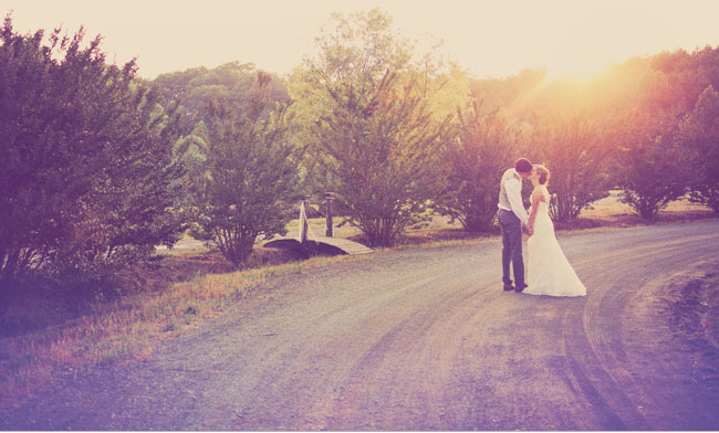 bride and groom on road