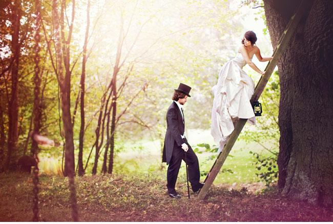 bride on ladder and groom