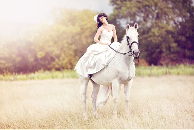bride with horse and flower hairpiece