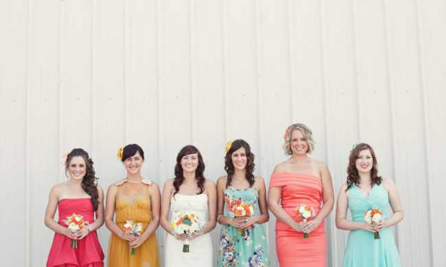 bridesmaids in peach, blue and yellow