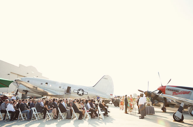 wedding ceremony at airplane hangar