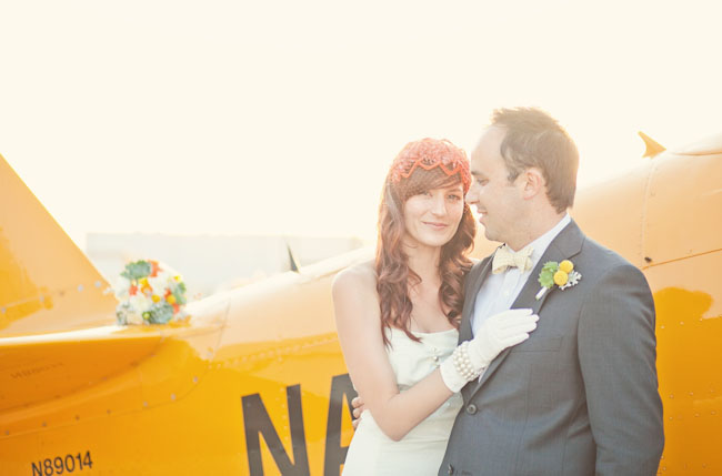 bride with gloves by airplane