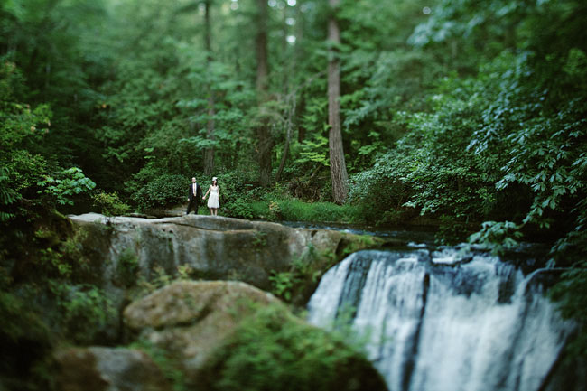 bride and groom by waterfall