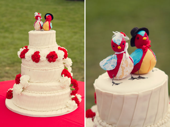 red and white cake with bird toppers