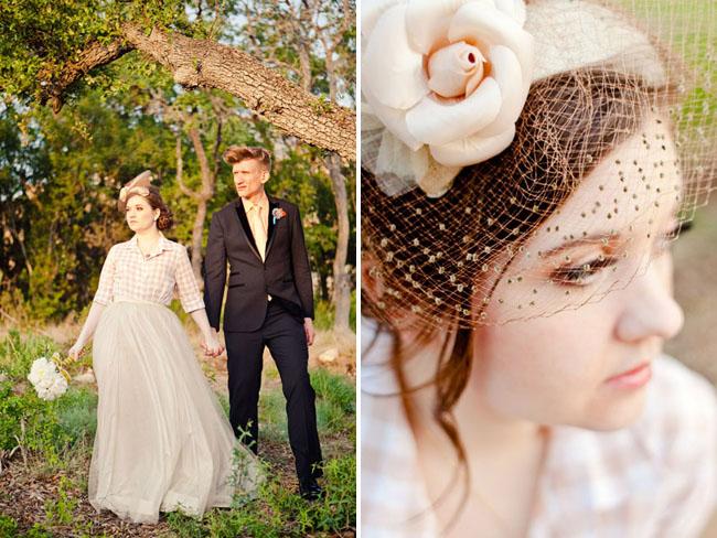 bride wearing flower hair piece with birdcage veil