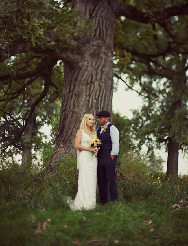 bride and groom under big tree