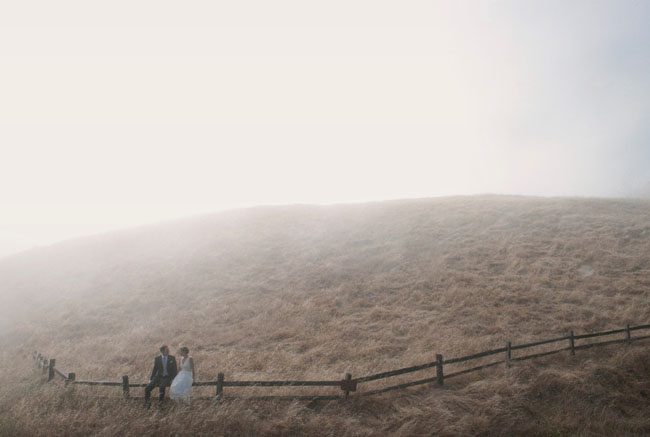bride and groom in fog