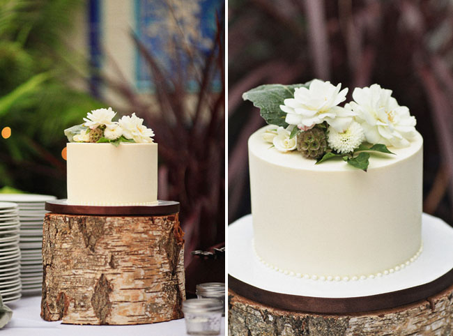 wedding cake on wood pedestal