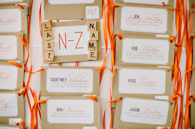orange escort cards with scrabble letters