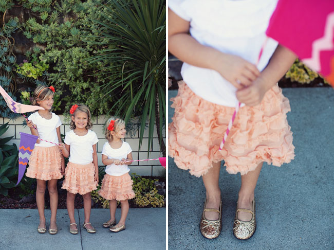 flower girls in gold flats and ruffle peach skirts